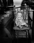 Dolly in high chair in shop