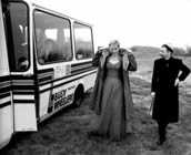 Annie Lennox and Dave Stewart by the bus after first video shoot