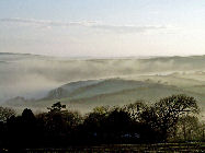 Morning mist over valley in Crackington, Cornwall